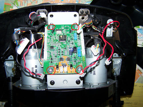 After removing the pcb, you will find the three screws, fixing the paddel shifter unit to the steering shaft
